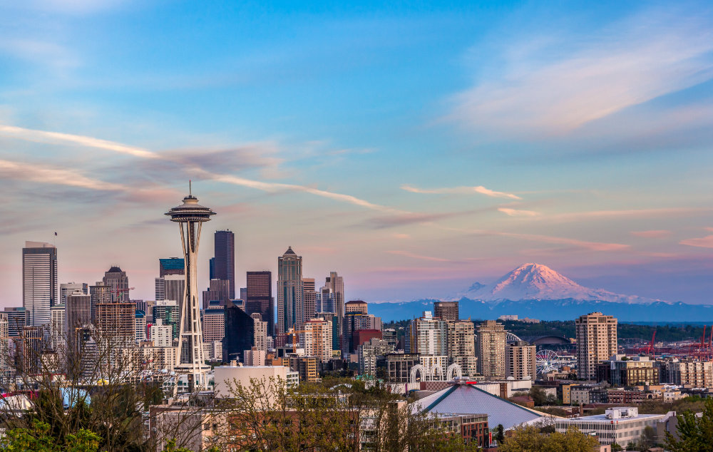 Seattle downtown skyline and Mt. Rainier at sunset. WA from Kerry park.